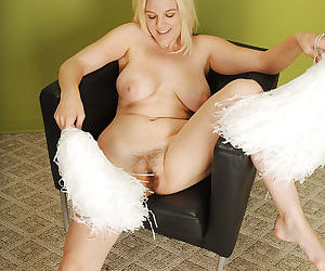 Big breasted blonde chick Prudence Pond stripping off cheerleader uniform