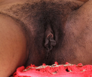 Older black woman Strawberry removes her top and panties in a teasing fashion