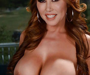 Busty MILF Kianna Dior strips off lingerie to reveal huge juggs