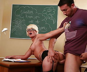 Mature teacher with blonde hair Summer Storm enjoys sex with her student