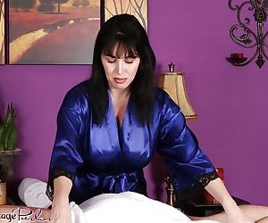 Staggering mature Rayveness massaging young fellows with no shame