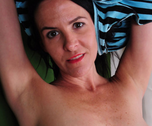 Mature vixen Natasha is going to entrance you with the view of her curvy body