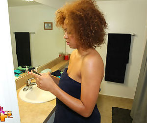 Busty ebony mom Kat soaps up her saggy black tits in the shower