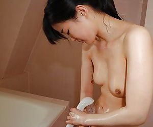 Cute asian babe Aika Tanuma playing with herself in the shower