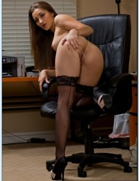 Foxy office babe Dani Daniels stripping and spreading her stockings clad legs