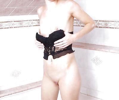 Fabulous blonde MILF spreading her pussy in bath.