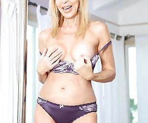 Blonde mom Erica Lauren strips and takes a spin around stripper pole