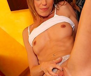 Blonde mommy Carly Bell spreading her recently shaved MILF pussy