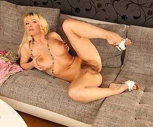 Older MILF Vanessa Lovely lifts pink top to expose large natural tits