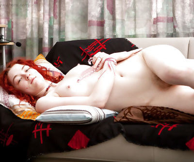 Redhead amateur Jessie T shows off all natural breasts after stripping nude