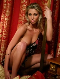 Sultry amateur Sweet Denisa drops her dress to expose hot tits & large nipples