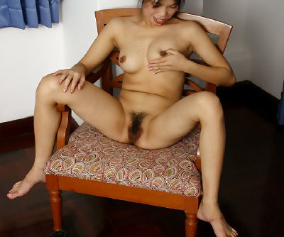 Close ups of amateur Oriental Diep spreading her hairy Asian cunt
