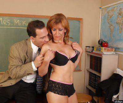 Older sex ed teacher Mikela eating cum from hand in classroom