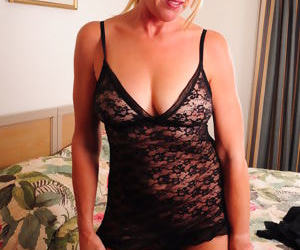 Mature MILF in lace lingerie strips to lick her hard nipples and toy her ass