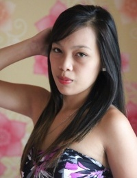 Young Filipino female removes her dress and underwear to pose in the nude