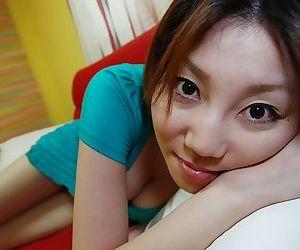 Asian teen Madoka Kanbe undressing and exposing her shaggy twat