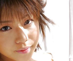 Big busted asian babe Mai Haruna stripping and licking her hard nipples