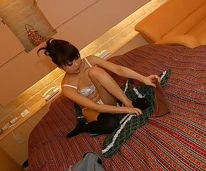 Asian MILF Miyuki Takizawa stripping and exposing her soaking hairy twat