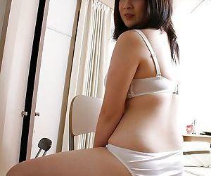Asian babe Momo Akiyama taking off her lingerie and toying her hairy gash