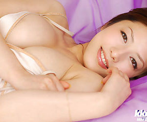 Adorable asian coed in lingerie showcasing her amazing melons