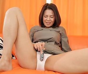 Asian MILF in pantyhose getting rid of her bottom and toying her cunt