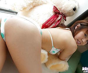 Asian teen in bikini Haruka Tsukino flashing her titties and hairy pussy