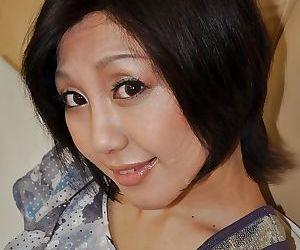 Pretty asian MILF Mayumi Iihara undressing and masturbating her cunt