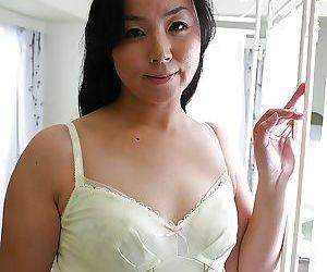 Playful MILF Takako Nishazawa revealing her small tits with hard nipples