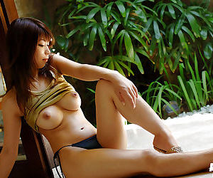 Amazingly sexy asian babe Hikari Hino gets rid of her clothes