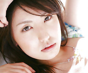 Sweet asian babe Takako Kitahara stripping and posing on the bed