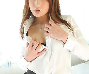 Beautiful Japanese girl Rara Mizuki undressing to reveal her sweet small boobs