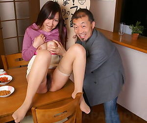 Japanese woman Nao Sakurai has help showing hairy bush on the kitchen table