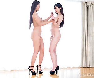 Naked Japanese females engage in lesbian sex acts in high heeled shoes