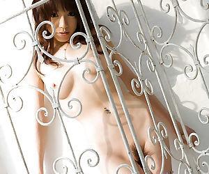 Tempting asian babe Kanako Tsuchiyai stripping off her clothes