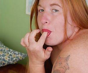 Older redheaded BBW Keno licking creampie off cunt for cum eating