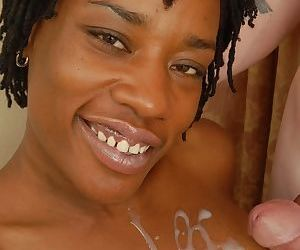 Ebony cougar Cat having older black woman pussy attended to by white boy