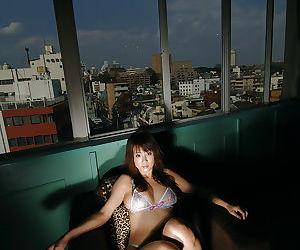 Petite asian babe Maki Hoshino slipping off her sheer lingerie