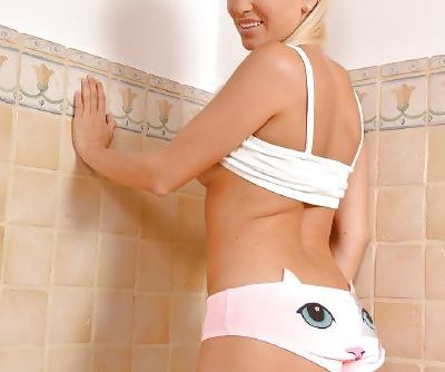 Stunning blonde Blanca Brooke undresses in the bath in a sexy style