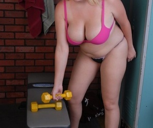 Chubby blonde girl Christal working out in the nude with big boobs hanging