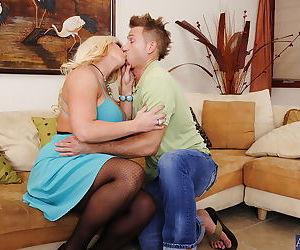 Lewd MILF Alura Jenson fucks a younger lad and gets her huge jugs jizzed