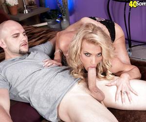 Older blonde woman Amanda Verhooks baring big tits while sucking cock