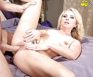 Mature blonde mom Nancy Jay stripped naked for hardcore sex in high heels