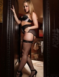 Sexy blonde slut Alexis Texas shows off her big ass in sheer black pantyhose