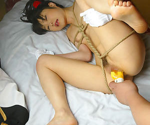 Bound asian coed gets her hairy twat stuffed with a sex toys
