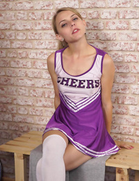 Hot cheerleader bends over for no panty upskirt and rubs her horny pussy