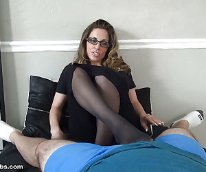 Fully clothed middle aged woman Sienna jerking off a cock with fervor