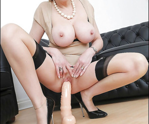 Well-stacked mature vixen on high heels riding a big dildo