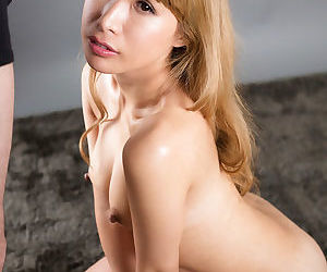 Blonde Japanese girl catches sperm on pretty face after giving a handjob