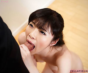 Nude Japanese female takes a money shot after giving a blowjob on her knees