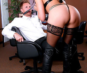 Dominant lady Raven LeChance in a hardcore foot fetish scene at the office